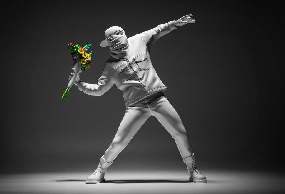 """O Banksy έχασε τη δίκη για τα δικαιώματα του διάσημου έργου του """"Flower bomber"""""""